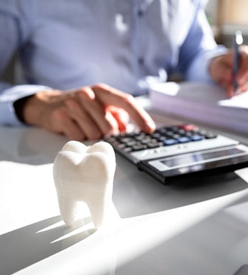 man calculating cost of Teeth in a Day