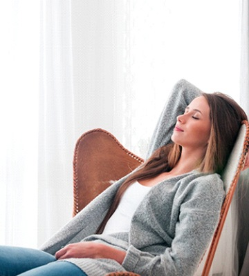 Woman relaxing at home following a tooth extraction