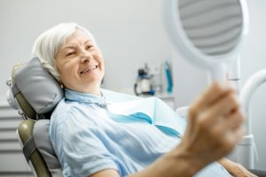Woman checking teeth and smiling