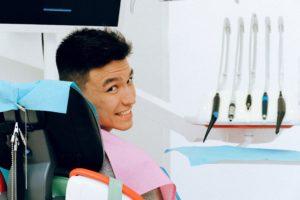 Man smiling during dental checkup.