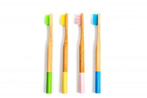 four bamboo toothbrushes, which are eco-friendly oral hygiene products