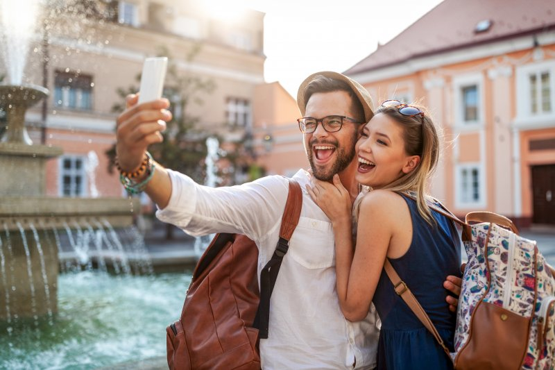 Couple smiling for a selfie during summer vacation
